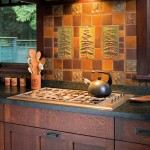Gorgeous art tiles (Handcraft Tile Co.) create an Arts & Crafts focal point over the modern range-top in a revival kitchen.