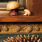 An acorn border (from Handcraft Tile Co.) adds style to a backsplash in a kitchen of the Arts & Crafts Revival.