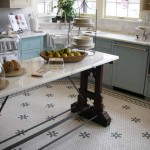 Hexagon-shaped tiles have become a classic, suitable for houses from Colonial Revival to Victorian and Beaux Arts, especially with accents or a border. Courtesy American Restoration Tile.