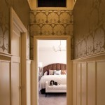 An upstairs hall's décor is inspired by the English Arts & Crafts movement with high wainscoting and period paper.