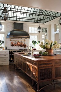 At the center of the kitchen is a freestanding custom table in walnut and burled-walnut veneers.