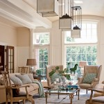 The ceiling in the entertaining room is barrel-vaulted. Light streams through large multi-paned windows.