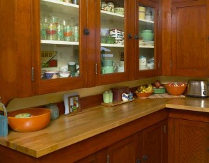A pantry cabinet within a colorful bungalow kitchen. Photo: Jaimee Itagaki