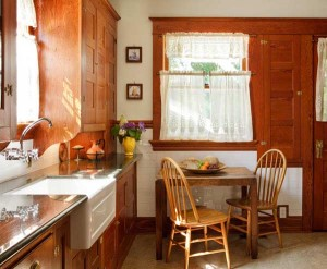 Friends and contractors pressed the owners to ditch the old fir cabinets. (You might understand if you'd seen them before they were degreased, realigned, and finished with lacquer.) Though it was updated, the kitchen couldn't be a better fit for its house. Photo: Philip Clayton-Thompson.
