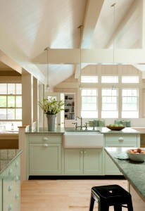 The farmhouse kitchen sink looks into the light-filled family room.