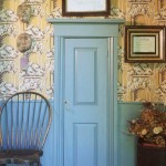 Parlor trim in a muted green complements the wallpaper, a Georgian/Federal-period design hung in the 1960s.