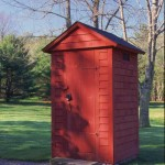 The red building is a replica outhouse (without facilities), today used to store gasoline.