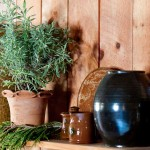 Lavandula 'Goodwin Creek' is potted in a container with a rim typical of Anthony Baecher's work; Wolff's stoneware vases share the shelf.