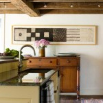 Glossy quartz juxtaposed with an antique buffet.