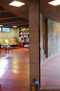 The innovative house is circular, with concrete block walls and curving walls of redwood-veneered plywood.