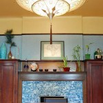 The dining room illustrates the owners' and architects' approach: Respect the architectural bones (note retention of the historic fireplace tile, picture rail, and coved plaster), but have fun with contemporary interpretation.