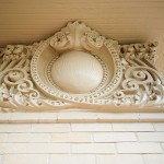 A detail of the exterior plaster frieze, re-created on the south and east sides.