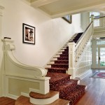A shadow visible in the previous photo guided the design of the decorative scroll on the stair landing.