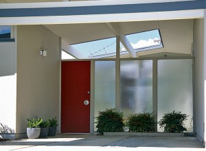 Visible behind this entry atrium (where one could also park a car) is an open indoor courtyard.