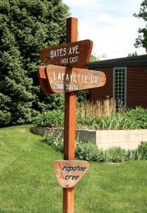 Groovy wooden signs mark the streets in Arapahoe Acres, south of Denver.