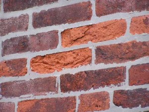 The results of too-hard mortar can be spalling of soft, pre-1860s brick.