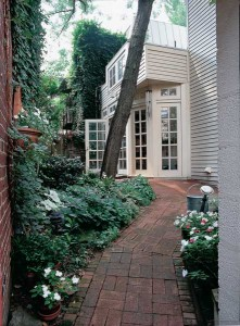 A back garden serves as a pathway to the house, which is used by the owner, who suffered a stroke. (Photo: David Duncan Livingston)