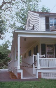 Access ramps don't have to be unattractive and clinical looking. This sensitive addition to this old house was constructed right onto the porch. (Photo: James C. Massey)