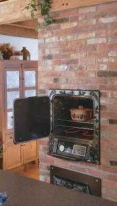 Wall ovens that swing out rather than down eliminate crouching and bending. (Photo: Brian Vanden Brink)