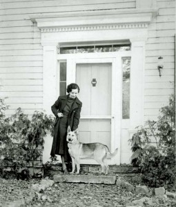 Katherine Van Meier and friend strike a pose before the classic Greek Revival front entrance of the Mower House. Katherine saved the house from oblivion when she and her husband, Dr. Henry Van Meier, bought it in the 1930s.