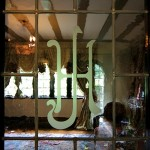 Original monogrammed French doors lead to the living room.