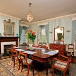The dining room's built-in china cabinet and the Federal wood window pelmets that hang above nine-over-nine windows are survivors of the 1830s, their style timelessly chic.