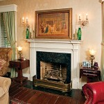 The floors and early 19th-century mantels are original, but Bob Guinn installed Italian marble fireplace surrounds downstairs when he bought the house during the Depression.