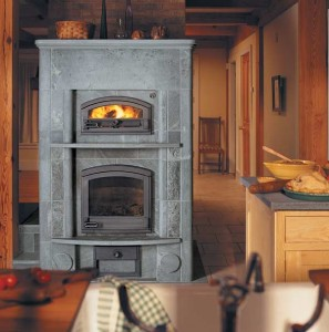 Soapstone fireplaces radiate warmth up to 24 hours after the fire has died. Because of its density, the stone stores heat and then releases it slowly. (Courtesy: Tulikivi)