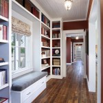 Ripped tobacco wood floors are found throughout the house. Floor-to-ceiling shelves in the hall offer ample book storage.