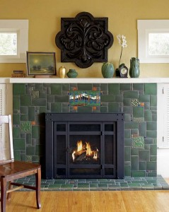 Green Motawi field tiles are combined with landscape and other decorative tiles in a seemingly random layout on this fireplace.