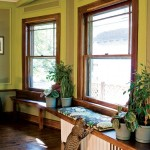 An existing window seat (restained by Tim and Paula) helps hide a radiator while providing a sunny perch in the dining room.