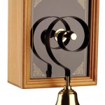 Victorian-era doorbells often featured an electric box that rang a simple brass bell; this reproduction is from Byron Bells.