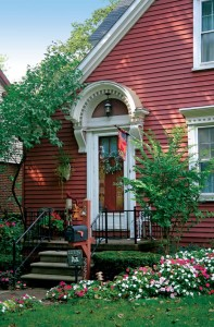 The decorative arched hood that appears over many doorways is one of several handsome Colonial features.