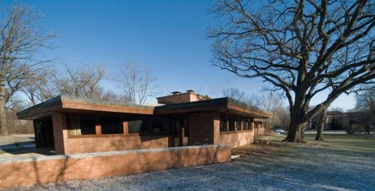 The low-slung house follows the principles of organic architecture and embraces its spacious, wooded lot.