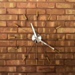 An integrated wall clock—dating to the house's construction—continues to keep perfect time.