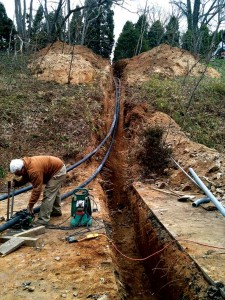 A trench between the bore field and the house holds both the refrigerant lines for the geothermal system and the electric wires for the solar array.