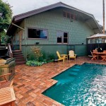 The small pool in the back yard has a fountain-like feel; to stay on budget, John and David chose to cover the patio with concrete pavers that simulate the look of variegated brickwork.