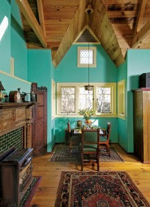 A bright paint scheme highlights the eclectic mix of salvaged and antique furnishings in the dining room.