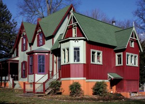 To highlight its different timeline, the addition is stepped down slightly from the original house and painted in a contrasting color scheme.