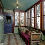 A screened porch, accessible from the rear entry door, runs across the back of the addition.