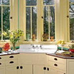 Carpenter Ed Mroczka designed a bank of fitted cabinets to house the salvaged farmhouse sink.