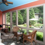 The new screened porch is adjacent to the outdoor patio.
