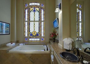 The LBJ Suite features stained glass adorned with bluebonnets and other wildflowers.
