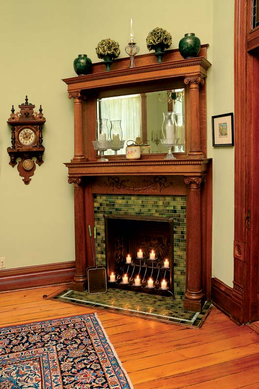 Reviving the victorian eitzen mansion old house online for Traditional dining room fireplace