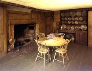 The kitchen in the Coffin House contains little more than a large cooking fireplace and a built-in cupboard for holding dishes.