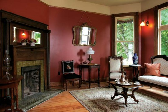 The downstairs rooms have a fall color palette, while rooms upstairs are painted in lighter shades.