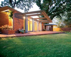 A prominent feature of Frank Lloyd Wright's Willey house, designed for a Minnesota professor and his wife, is an expansive cantilevered trellis, which appears to hover over a row of French doors.