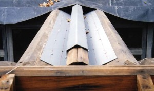Custom-made steel stiffeners shaped like a W help strenghten the trellis support beams. They were  later covered with plywood and ice-and-water shield, and capped in copper.