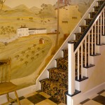 A new mural and painted checkerboard floor decorate the old stair hall.