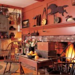 Dignified Windsor chairs join primitive collections in a hearth room.